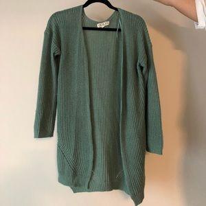 Green cardigan sweater